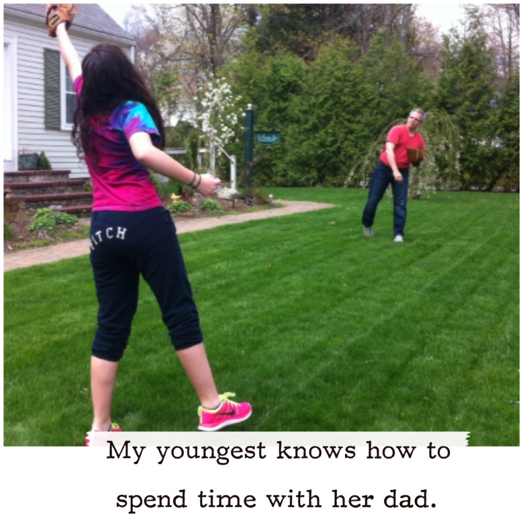 Dad and daughter playing catch with baseball.