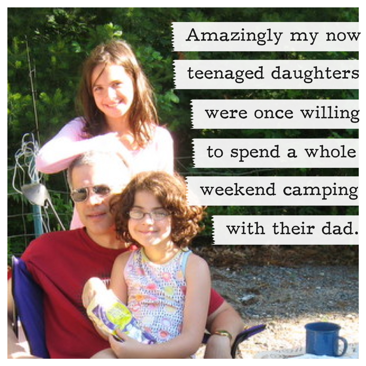 Father and two daughers at a campground