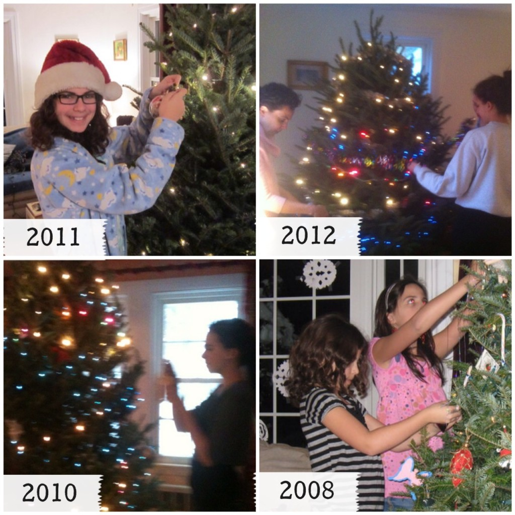 Family hanging ornaments on Christmas tree.