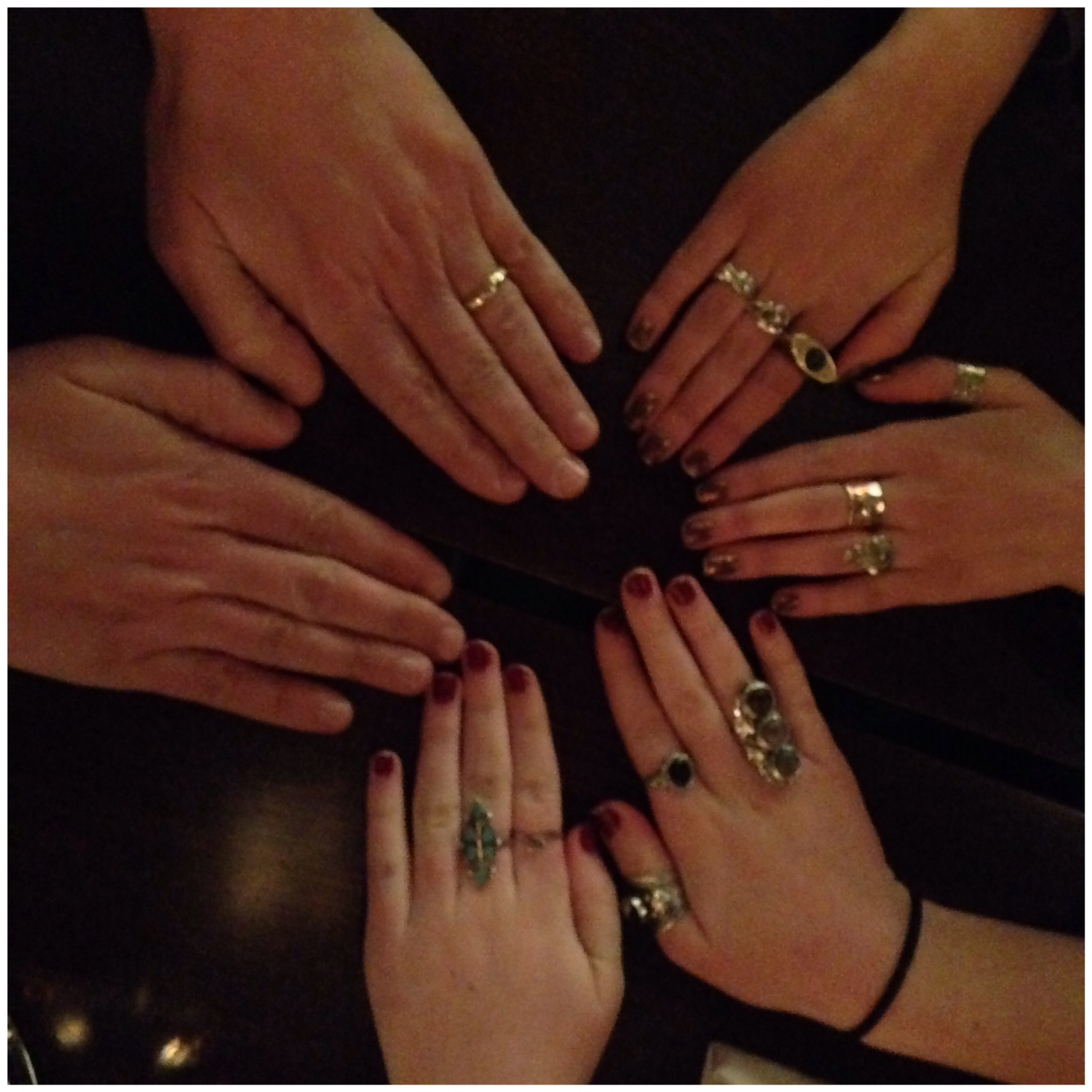 Teens girls wear lots of rings.